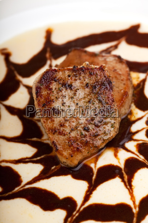 small veal steak on a bed