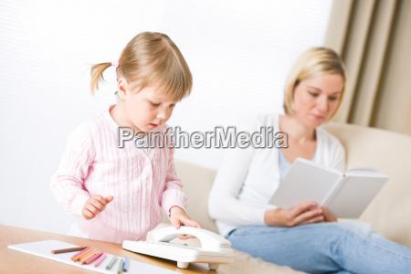 little, girl, on, phone, in, living - 3154231