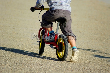 child on bicycle partial view