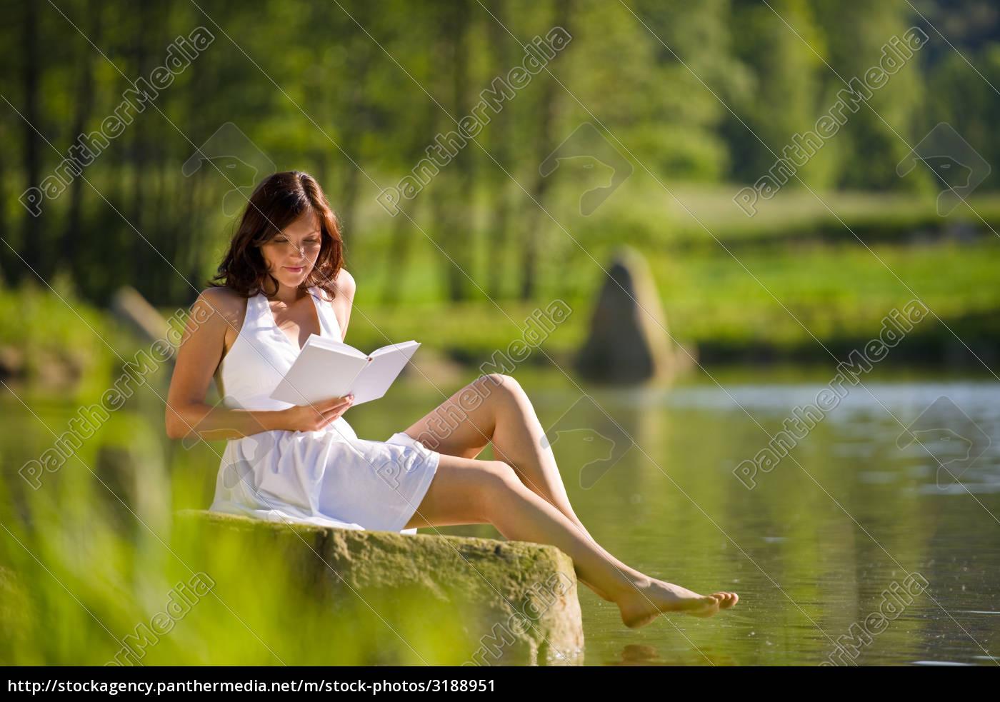 happy, romantic, woman, sitting, by, lake - 3188951
