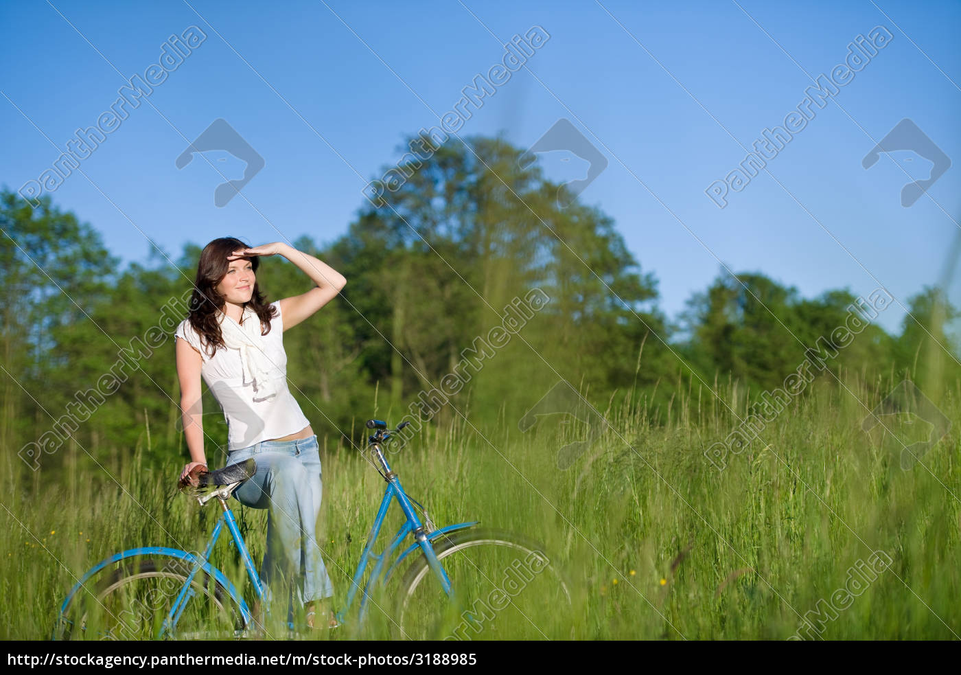 woman, with, old-fashioned, bike, in, meadow - 3188985