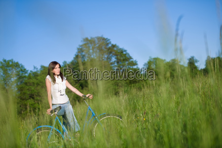 woman, with, old-fashioned, bike, in, meadow - 3191221