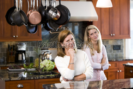 mother in kitchen with teenage daughter