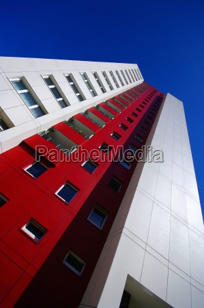 highrise skyscraper in red with white