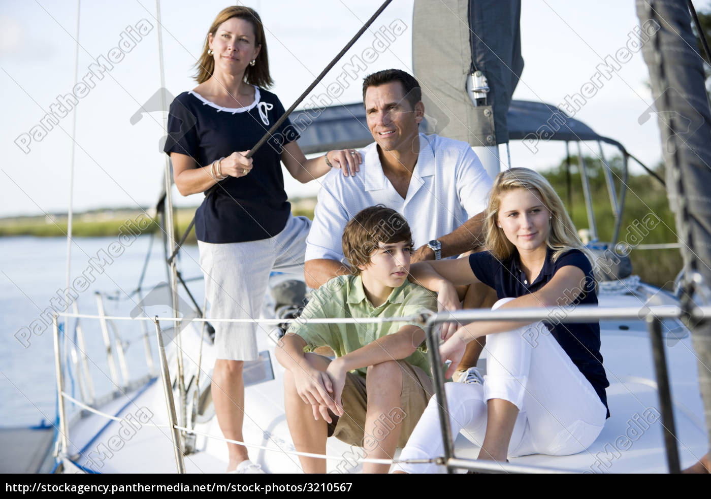 happy, family, with, teenagers, on, sailboat - 3210567