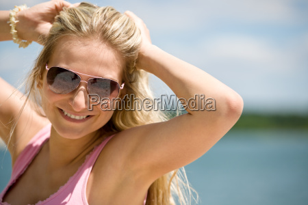 blond woman with sunglasses enjoy sunny