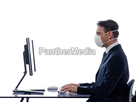 man computer wearing protection mask