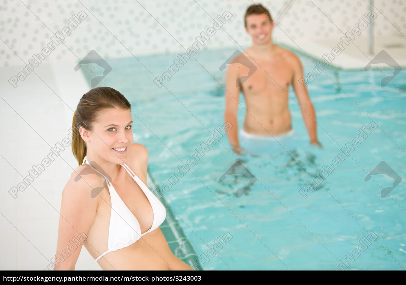 young, couple, relax, in, swimming, pool, - 3243003