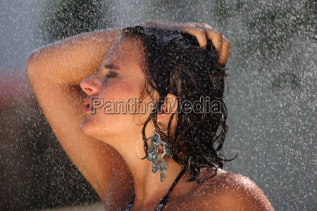 young, woman, takes, a, shower - 3257969