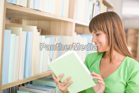 student in library happy woman