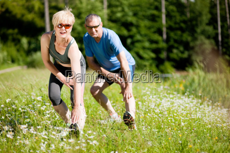 mature couple doing sport in nature