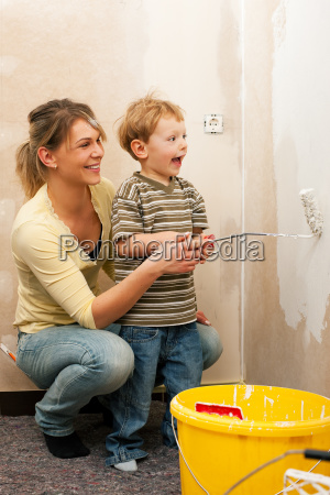 family sweeps wall of new home