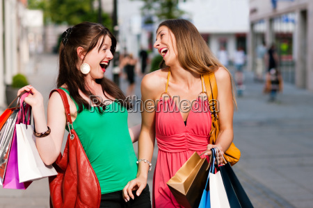 women at shopping with bags