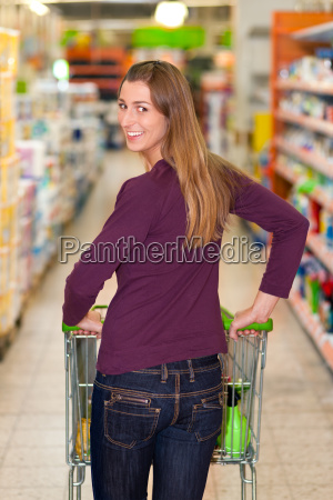 woman in the supermarket with shopping
