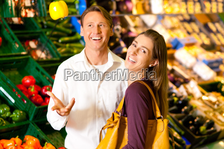 people in the supermarket to buy