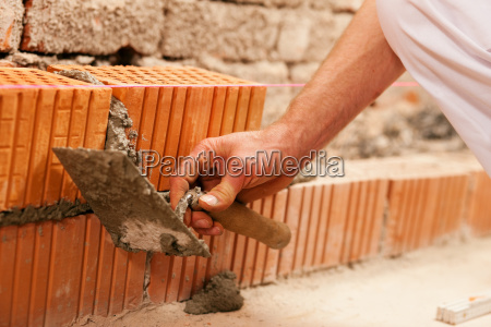 mason supported wall with stones and