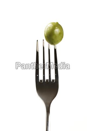 an olive on fork