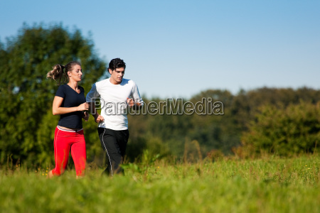 sport couple jogging in summer