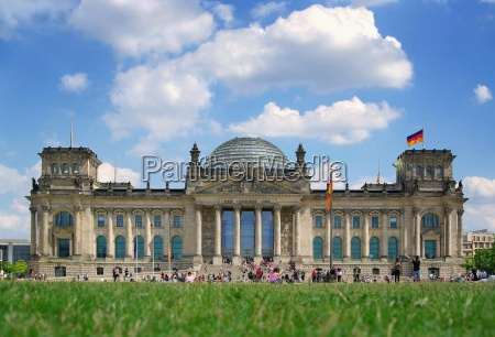 reichstag berlin with germany flag