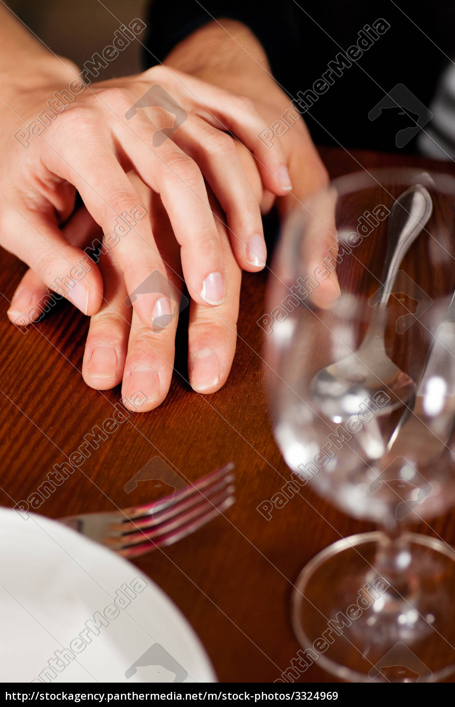 Royalty free image 3324969 - couple hällt hands on table