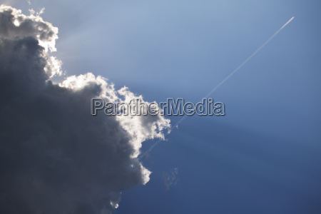 contrails and a dark cloud