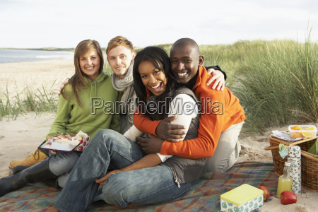 group of young friends enjoying picnic