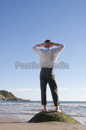 businessman relaxing on a beach