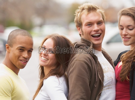 two couples posing together outdoors
