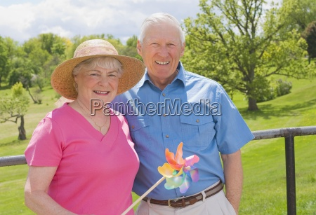 senior couple at park with toy