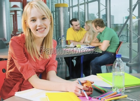 female college student working on assignment