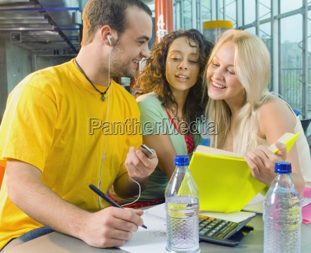 college students listening to mp3 player