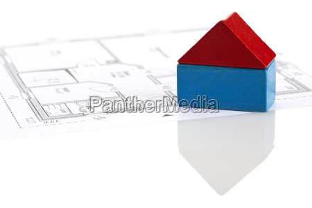 toy block house on blueprint of