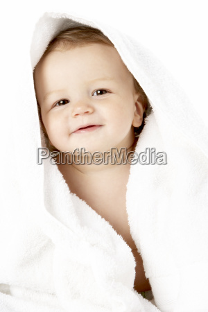 studio portrait of baby boy wrapped