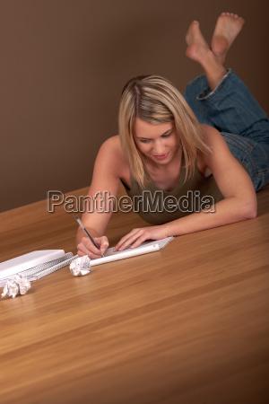 student happy woman write homework