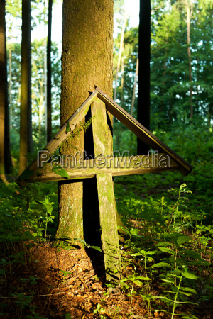 old wooden cross in the forest