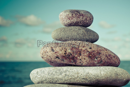 close up of stacked pebbles on