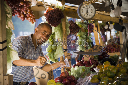 portrait of a fruit seller splashing