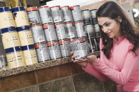 woman holding a paint can in