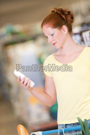 shopping beautiful woman hold shampoo