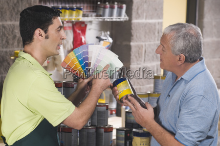 sales clerk assisting a customer in