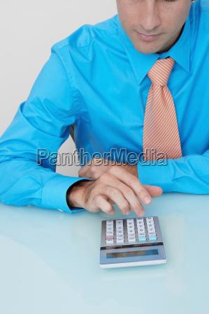 businessman using a calculator in an