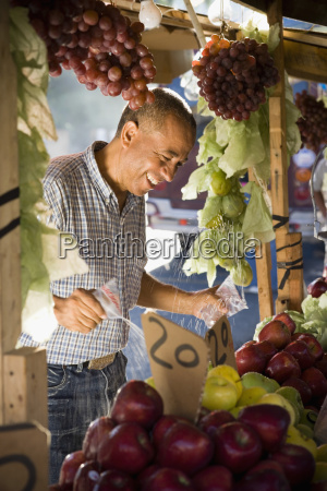 fruit seller splashing water over fruit