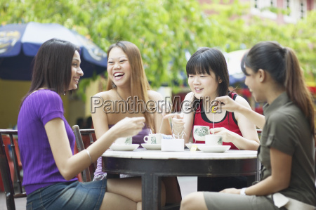 four young women sitting in an