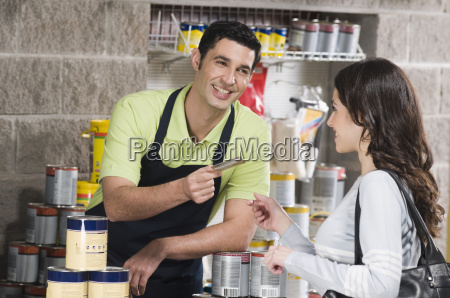 woman paying by a credit card