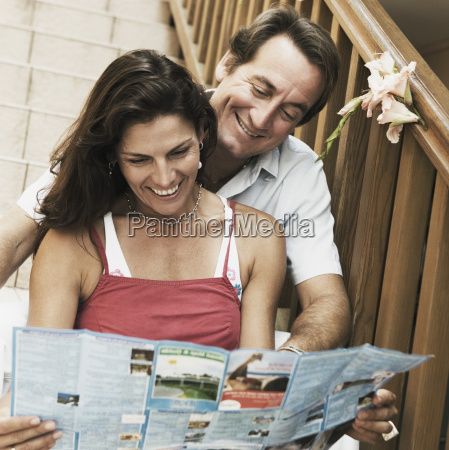 mid adult couple sitting on a