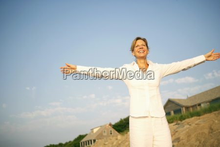 mature woman smiling with her arms