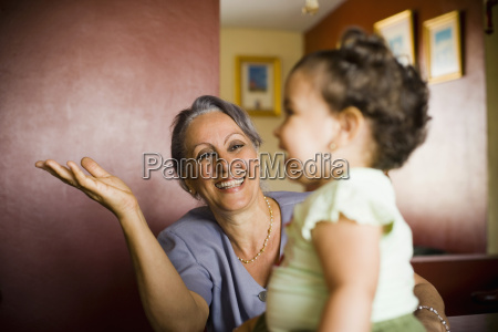 mature woman looking at her granddaughter