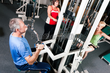 older people train in the gym