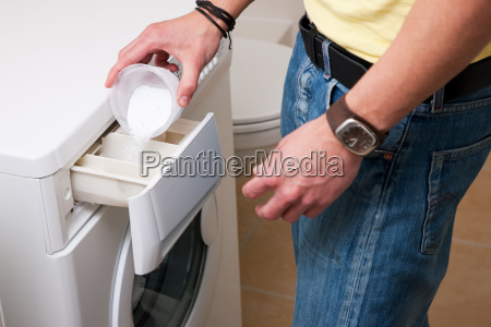 man washing clothes with machine