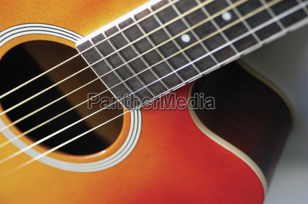 close up of guitar its strings